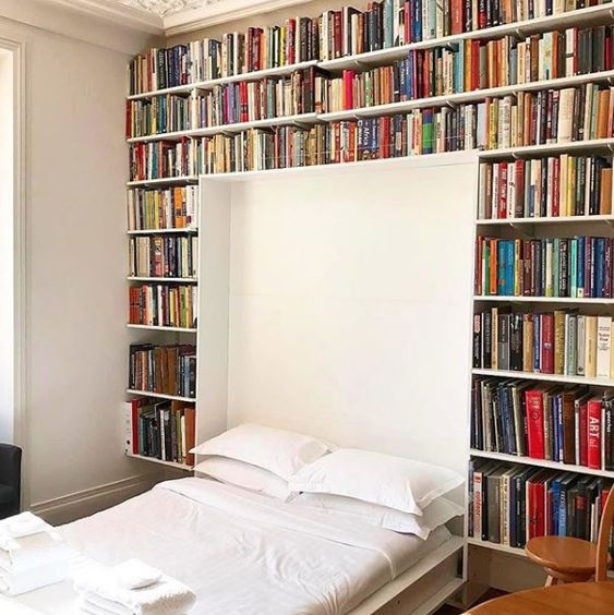 a library with a built-in Murphy bed - make your space more functional and squeeze maximum of it