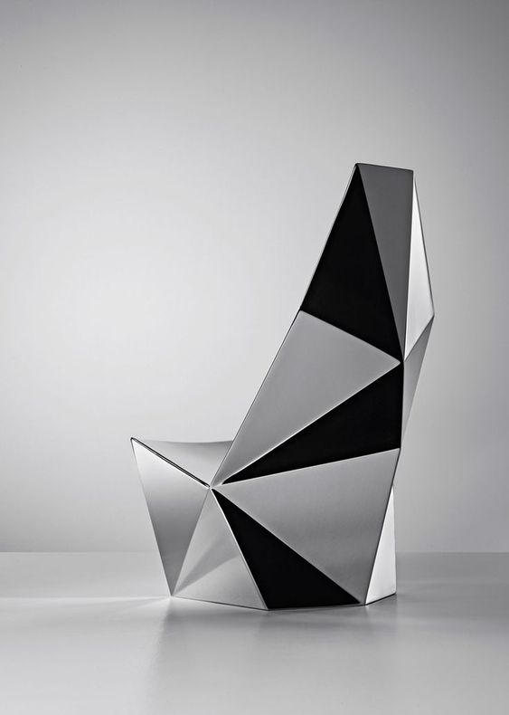 a geometric lounge chair inspired by diamonds and rocks looks amazing and will fit many modern or minimal spaces