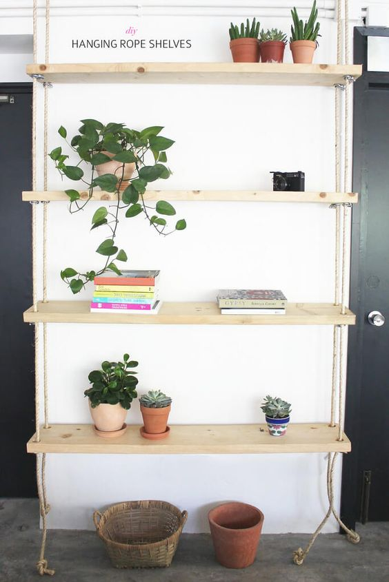 a simple contemporary hanging shelving unit with ropes can be a perfect solution for an awkward nook