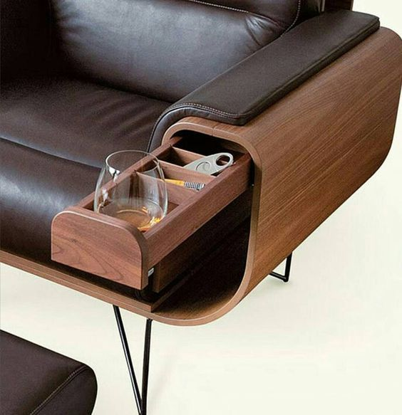 a small drawer hidden in the stylish leather upholstered sofa is a cool idea to save some space with style