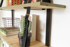 21 a two-layered hanging shelving unit done with plywood and leather belts is a cool modern idea