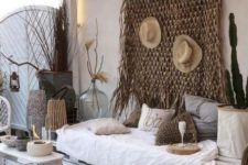 21 a whitewashed pallet daybed with lots of crochet pillows is the centerpiece of this desert-inspired boho outdoor space