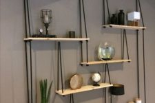 22 a whole hanging shelving unit with several shelves and black ropes looks very contrasting and will fit any boho room