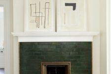 22 accent your small fireplace with dark green tiles and abstract artworks on the mantel if your home is mid-century modern or contemporary