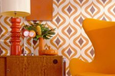 22 bright abstract wallpaper and a matching yellow egg-shaped chair for a chic retro nook