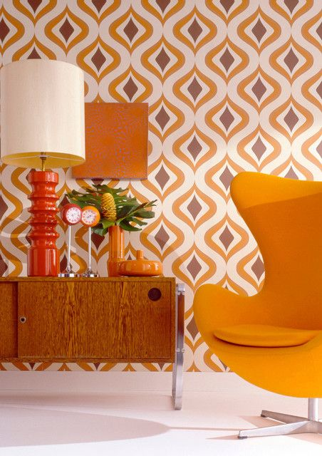 bright abstract wallpaper and a matching yellow egg-shaped chair for a chic retro nook