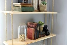 23 an industrial pipe with a hanging shelving unit with thin plywood tiers and ropes is a cool idea for an industrial space