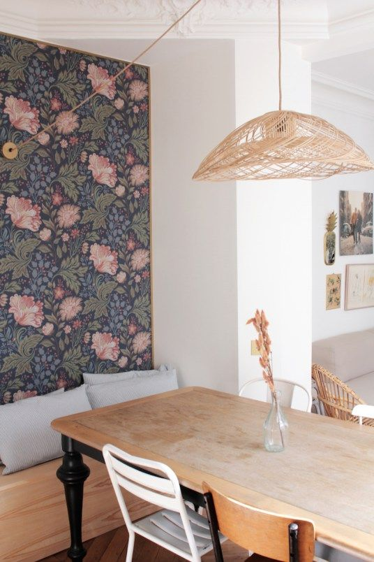 dark floral wallpaper on the accent wall instantly makes the dining space retro and stylish