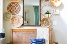 23 give your entryway a bold summer feel with a wall of decorative baskets – painted and printed ones and a striped pillow