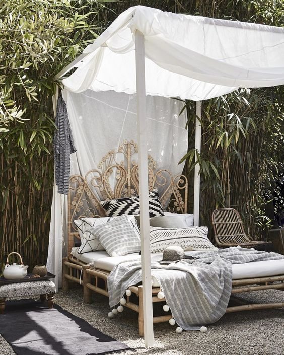 an exquisite carved wooden daybed with a canopy is amazing for a tropical or boho retreat