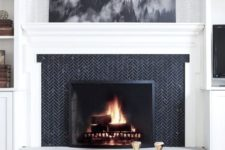 24 if you have a monochromatic space, clad your fireplace with black tiles in a herringbone pattern and add stone for a chic look
