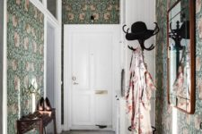 24 moody green floral wallpaper covering all the walls takes over the whole space and makes it cooler