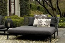 25 a contemporary dark daybed with printed pillows will accommodate more than one person and will add a modern feel to the space