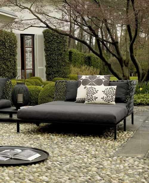 a contemporary dark daybed with printed pillows will accommodate more than one person and will add a modern feel to the space