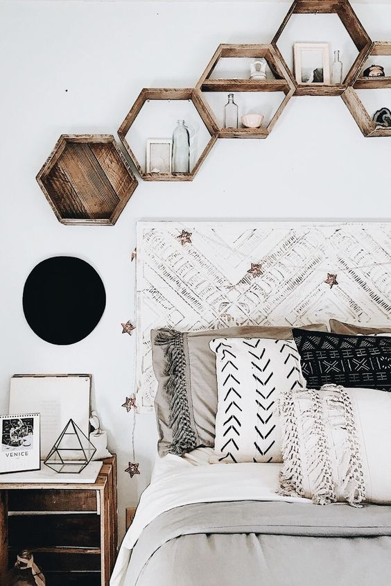 hexagon-shaped wooden shelves attached over the bed perfectly finish off the boho bedroom decor