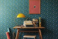 25 teal wallpaper with a unique abstract pattern will easily make the space retro and mid-century chic