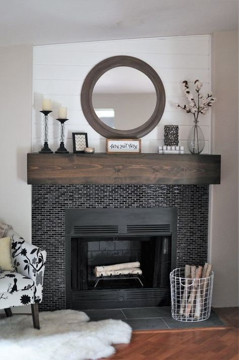 tiny glossy black tiles around the fireplace and a dark stained mantel make the fireplace zone cooler and bolder