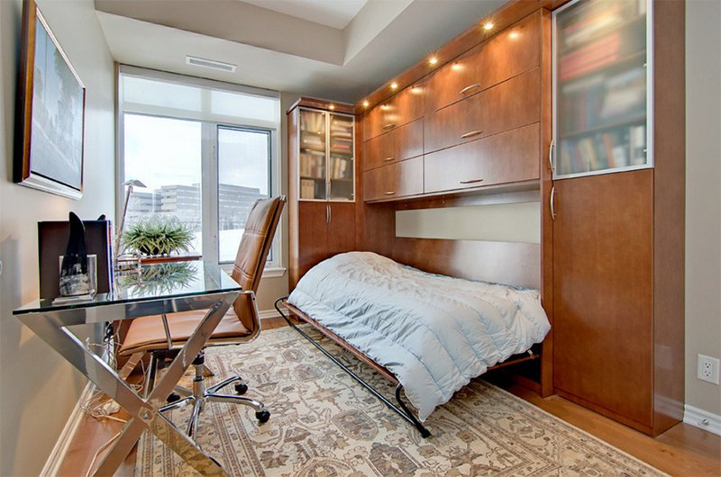 an elegant home office with a built in Murphy bed for guests or just to nap