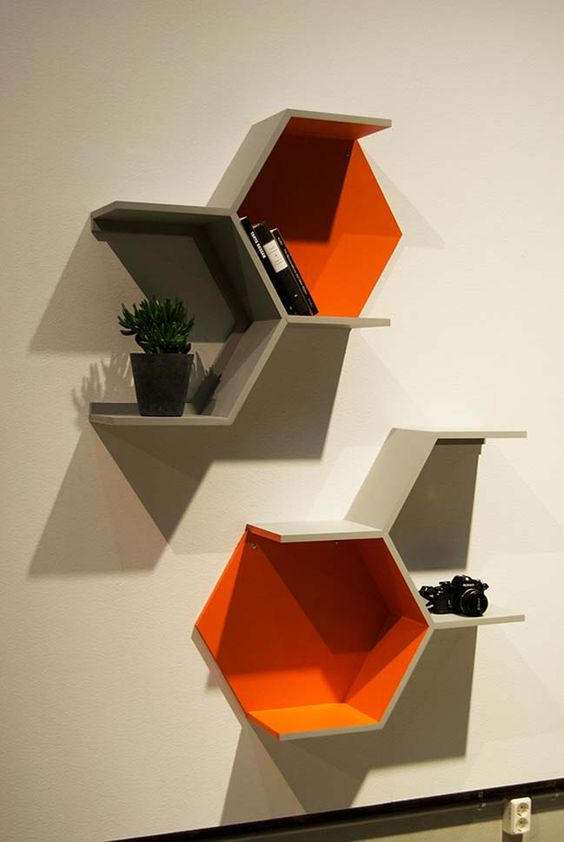 part hexagon shelves in grey and bold orange are a nice idea for storage and make a statement with the shape and color