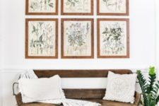 26 tropical leaves in a vase, baskets for storage and vintage botanical posters as artworks for a summer feel