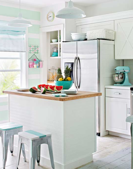 X detailed cabinets are paired with industrial stools, vintage fittings and touches of turquoise