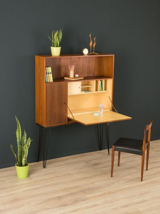 a Murphy desk integrated into a mid century modern storage unit with hairpin legs, the unit features much storage