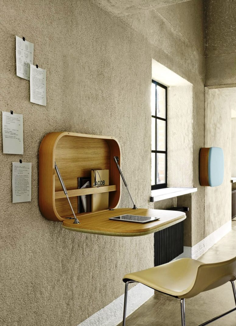a chic wooden Murphy desk with curved angles and some storage for notebooks inside is a stylish option