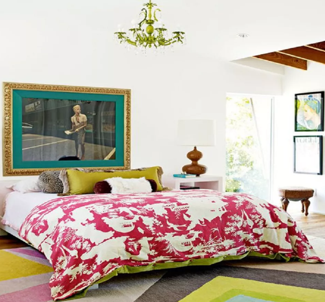 a colorful eclectic bedroom in a bright mix of colors, with bold artworks and a boho chandelier