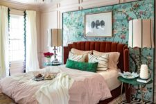 a colorful eclectic sleeping area done in aqua, emerald, burgundy and with touches of gold plus various prints