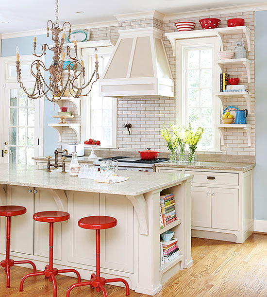 a fancy eclectic kitchen presents refined details and relaxed furniture plus a playful chandelier