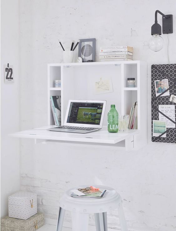 a minimalist white Murpy desk with storage compartments and a small desktop plus a white stool for an airy space