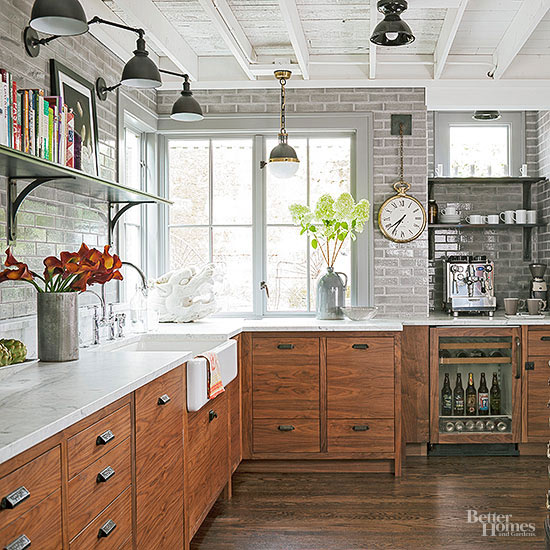 a modern meets industrial kitchen with rustic wood cabinets, white marble countertops and high tech gadgets