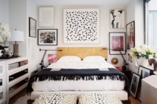 a monochromatic eclectic bedroom with a dashing gallery wall, two animal printed ottomans and mirrored dressers