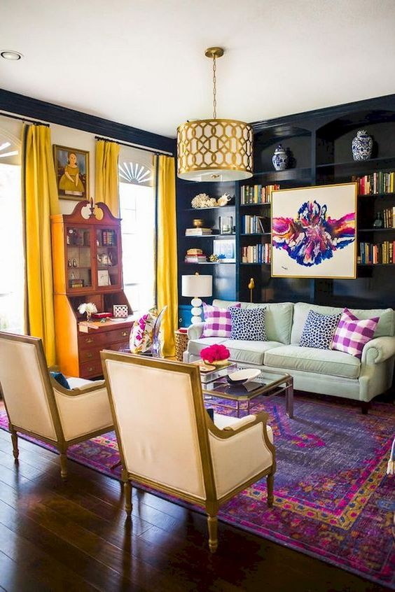 a moody yet bright eclectic living room with dakr walls, yellow curtains, printed pillows and a boho rug plus a vintage buffet
