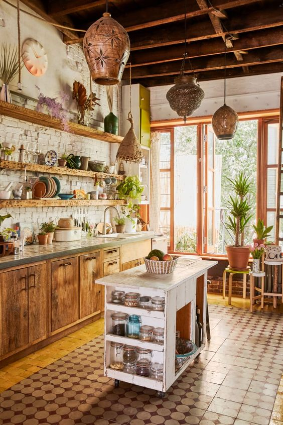 a rustic meets boho kitchen with Moroccan lanterns, wooden cabinets and a shabby chic kitchen island