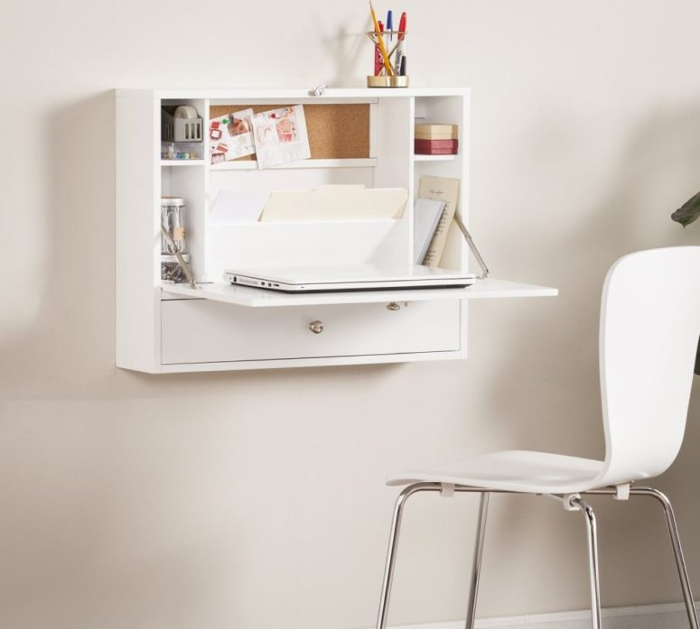 a sleek white Murphy desk with a small desktop for a laptop and some storage compartments inside is a cool idea