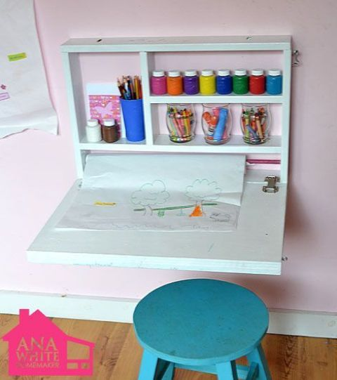 a small and minimal kid's Murphy desk done in white will become a cool yet small art center that won't take much space