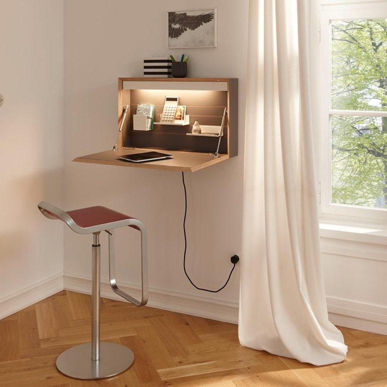 a small and sleek Murphy desk with a desktop, some shelves inside and additional light, which is great for a corner