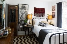 a small eclectic bedroom mixing up boho and mid-century modern decor and with an elegant mix of black and white