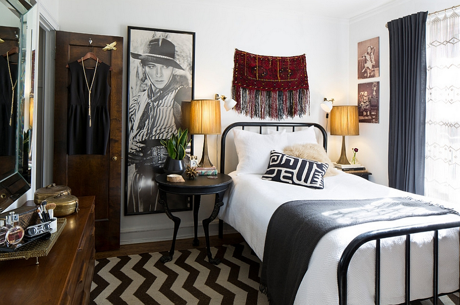 a small eclectic bedroom mixing up boho and mid century modern decor and with an elegant mix of black and white
