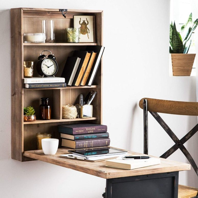 a stylish rustic Murphy desk of stained wood with a black top features also a shelf for storage, not just a desktop itself