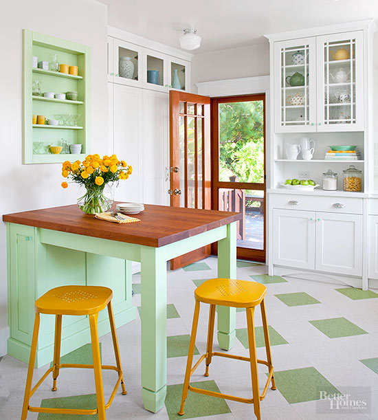 a traditional kitchen gone contemporary with a bold color palette - green and yellow for a fresh touch