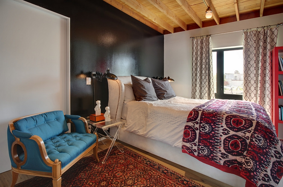 an eclectic bedroom featuring a beautiful transition between various decor styles and a mix of colors and prints