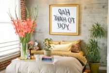 an eclectic bedroom with an animal print, bricks, an acrylic console, a mint chest and other touches of glam