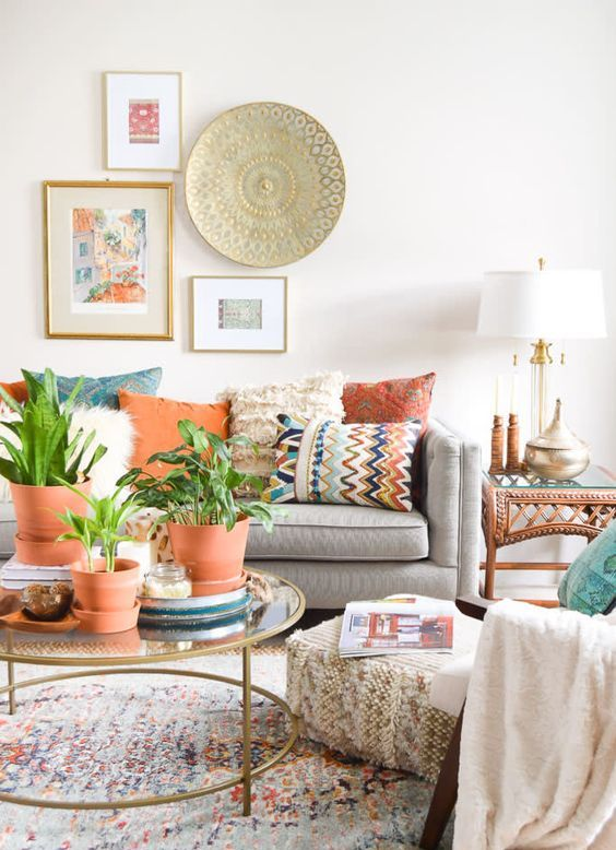 an eclectic living room with terracotta touches, folksy and boho decorations and a unique gallery wall