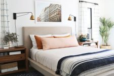 an eclectic sleeping space with an upholstered bed, wooden mid-century nightstands, vintage glam lamps and much more