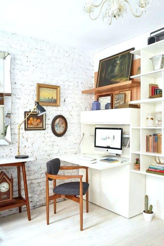 an eclectic space with a storage unit and a built-in Murphy desk that can be hidden any time