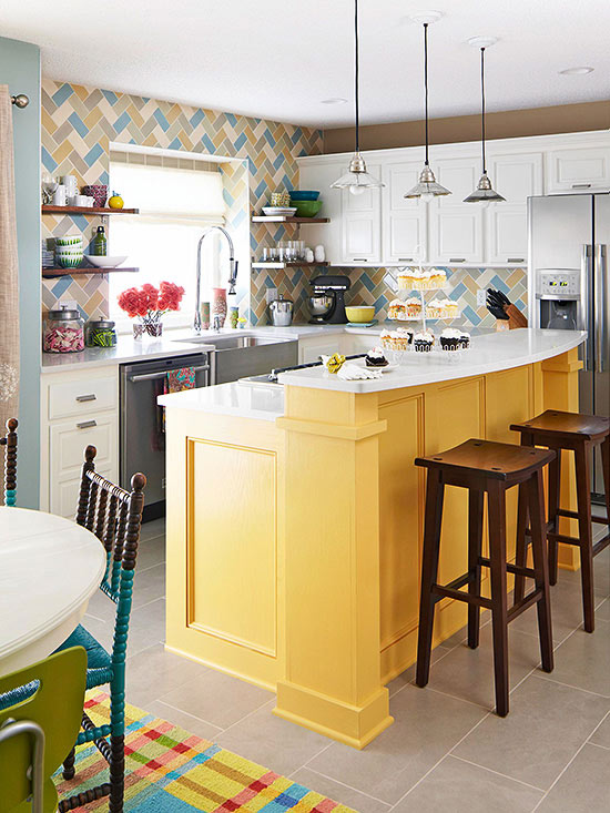 farmhouse style cabinets in white and yellow paired with a bright herringbone tile backsplash and industrial pendant lamps