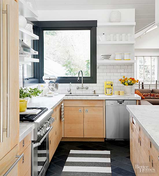 modern cabinets, white subway tiles and classic marble countertops paired with dark touches create a modern meets retro look