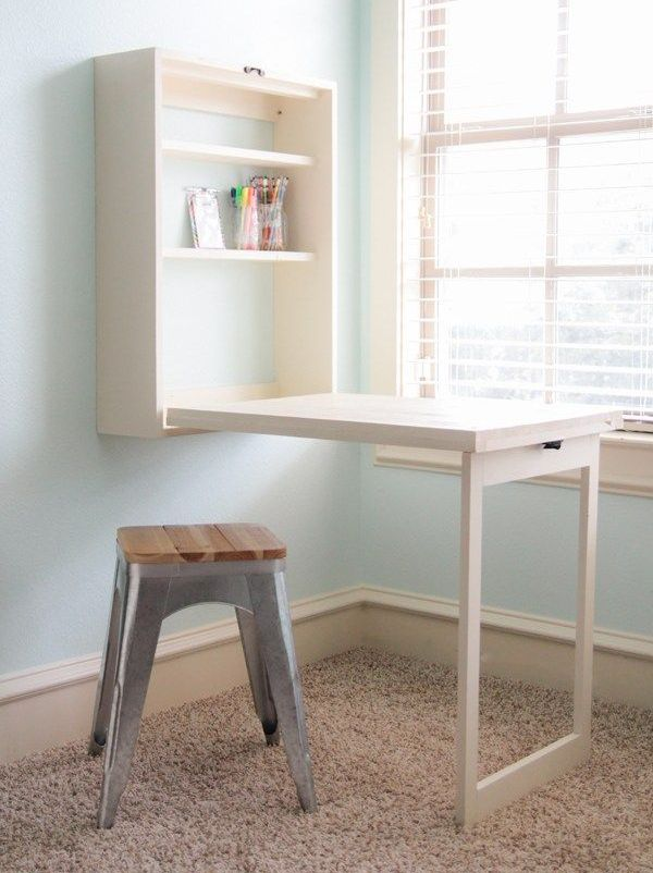 such a Murphy desk can be easily DIYed, it features much storage space and a large desk, which is enough for crafting, too